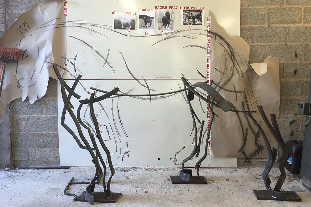 Shire Horse Metal Sculpture in the process of being built against the original sketch