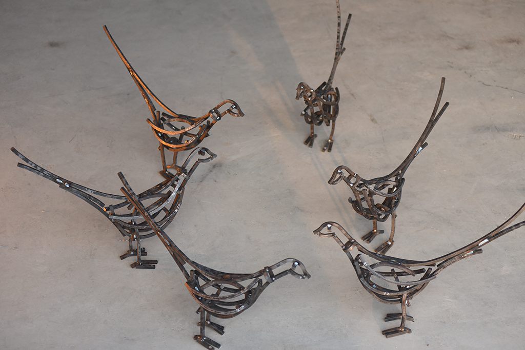 A circle of Pheasants Wildlife Sculptures before they go to their new home