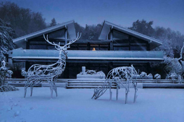 Reed Deer Wildlife Sculpture standing in the snow in the middle of winter