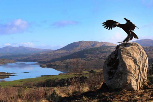 Golden Eagle swooping down on its prey overlooking Co Donegal. Life Size Bronze Metal Wildlife Sculpture by Andrew Kay