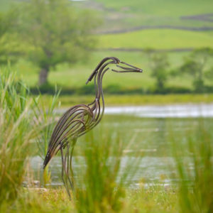River Heron Wildlife Sculpture standing by river watching for food