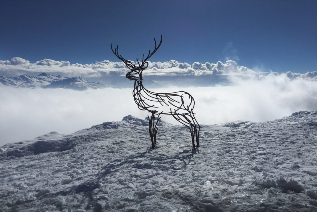Wildlife Sculpture of Watchful Stag in the snow, high in the Swiss Alps