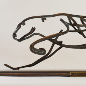 Bronze running Cheetah on a plinth