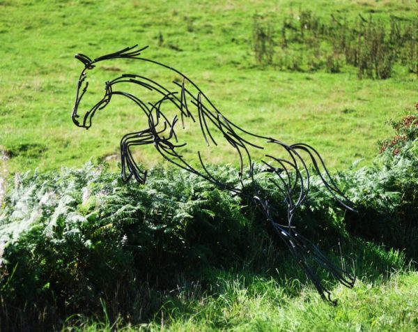 Wildlife Sculpture of Stallion leaping over a hedgerow