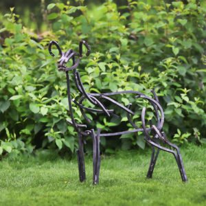 Young Fawn standing by a hedge waiting for it's mother. Metal Wildlife Sculpture by Andrew Kay Sculpture