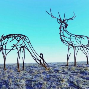 A stag and doe grazing on the Moors metal wildlife sculpture by Andrew Kay Sculpture
