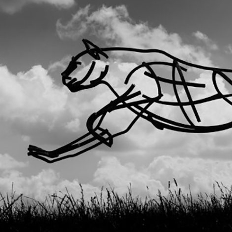 Cheetah running through the fields at dusk. Life Size Wildlife Sculpture by Andrew Kay Sculpture