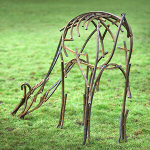 Wildlife Sculpture of a Doe grazing in the field