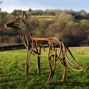 Wildlife Sculpture Dog Fox standing in the field in the winter sun