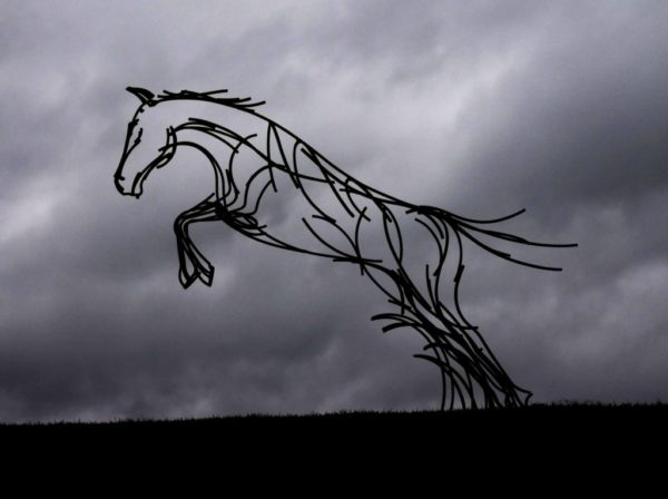 Stallion Sculpture ready to leap over the fence