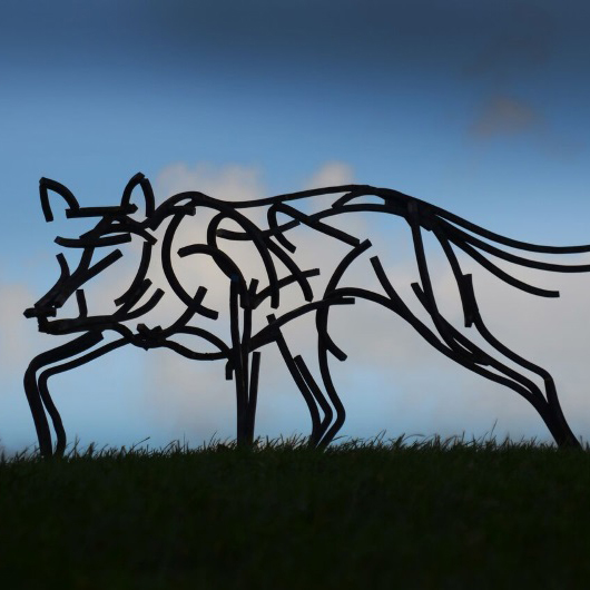 Wildlife Sculpture of Timber Wolf prowling as the sun sets by Andrew Kay Sculpture